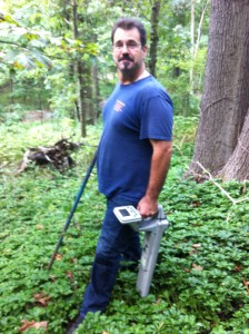 "Andy Sabo of Cheap Snake hunts for a ""lost"" septic tank with his electronic locator."