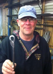 Master blacksmith Bill Fitzgerald displaying a staircase element a customer asked him to recreate from a magazine.