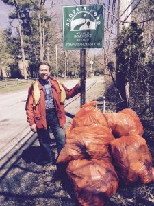 "The Home Guru with his stash of trash from his hometown's litter clean-up day, ""The Battle of Yorktown."""