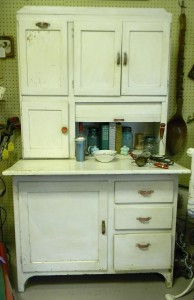 Early example of a Hoosier Cabinet, produced in the early 1900s for kitchen storage.