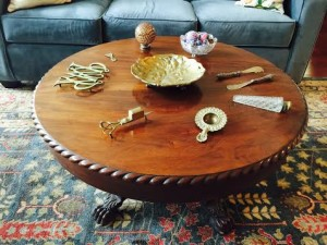 The Home Guru's coffee table with its odd assortment of collectibles.