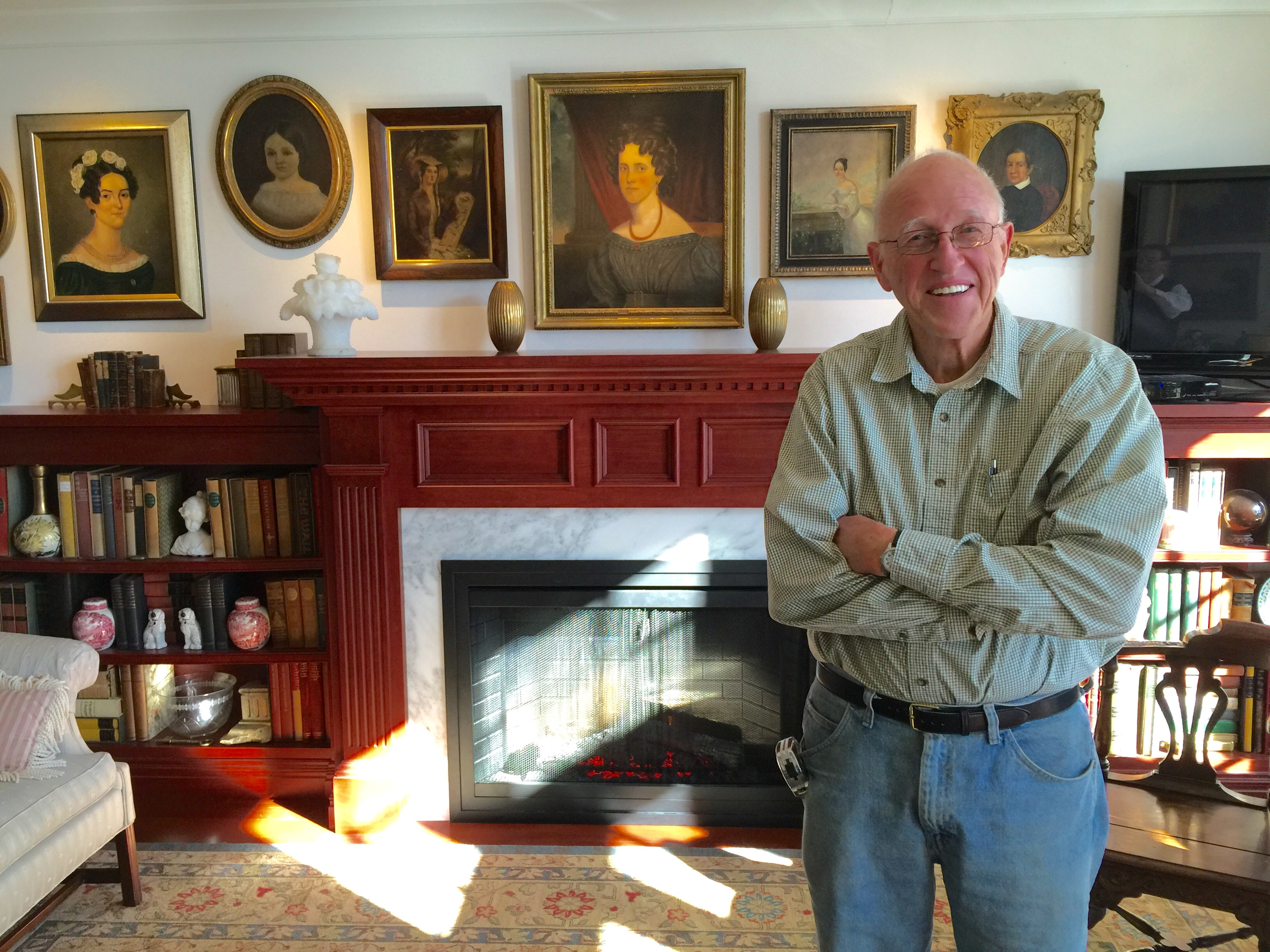 Jan Efraimsen Of Woodtronics Millwork Corp. Stands In Front Of The Mantel  And Bookcases His