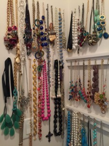 A collection of necklaces in plain sight make accessibility and coordination easier, while creating wall art of sorts.