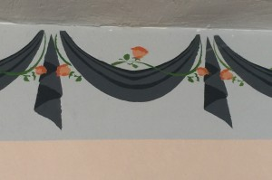 A faux border of swags and jabots painted years ago with stencils and freehand by the Home Guru.