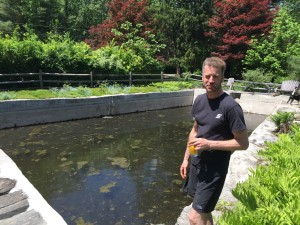 Matt Blunt in the process of draining the nearly 100-year old spring-fed pool on the property he and his mother Rebecca restored in Carmel.