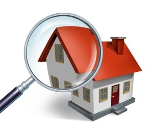 11840300 - house hunting and searching for real estate homes for sale  that need to be inspected by a home inspector concept as a magnifying glass inspecting a model single home building structure.